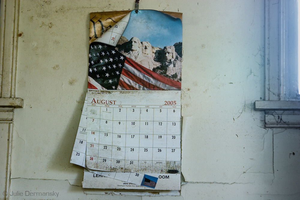 Calender on the wall of a home destroyed by Hurricane Katirna
