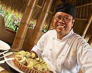 Pastry chef Pak Gede serves up a lime coconut pie. with a nut crust.