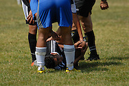 Fabian Lopez (#16) of Deportivo Colomex is on the ground after getting tangled up during a breakaway against Team Shlama F.C. during National Soccer League play in Skokie, Il.