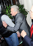 24.FEBRUARY.2011. LONDON<br /> <br /> CATHERINE ZETA JONES AND MICHAEL DOUGLAS LEAVING CLARIDGES HOTEL IN MAYFAIR AFTER CELEBRATING CATHERINE'S MBE THAT SHE RECEIVED EARLIER IN THE DAY BEFORE HEADING BACK TO THEIR OWN HOTEL, WHERE MICHAEL DOUGLAS WAS INVOLVED IN A SCUFFLE WITH A MALE PHOTOGRAPHER AFTER CATHERINE ZETA JONES CRIED OUT THAT HE HIT HER AS THE COUPLE TRIED TO GET INTO THE HOTEL DOOR ENTRANCE AND ALSO MICHAEL HAD A VERY BAD BLOODSHOT EYE.<br /> <br /> BYLINE: EDBIMAGEARCHIVE.COM<br /> <br /> *THIS IMAGE IS STRICTLY FOR UK NEWSPAPERS AND MAGAZINES ONLY*<br /> *FOR WORLD WIDE SALES AND WEB USE PLEASE CONTACT EDBIMAGEARCHIVE - 0208 954 5968*