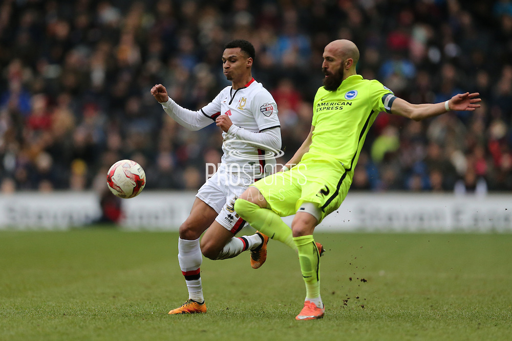 Brighton defender, Bruno Saltor (2) and Milton Keynes Dons midfielder Josh Murphy (31) during the Sky Bet Championship match between Milton Keynes Dons and Brighton and Hove Albion at stadium:mk, Milton Keynes, England on 19 March 2016.