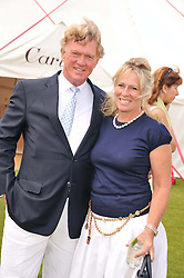 BROOK JOHNSON and his wife SALLY at the Cartier Queen's Cup Polo Final, Guards Polo Club, Windsor Great Park, Berkshire, on 17th June 2012.
