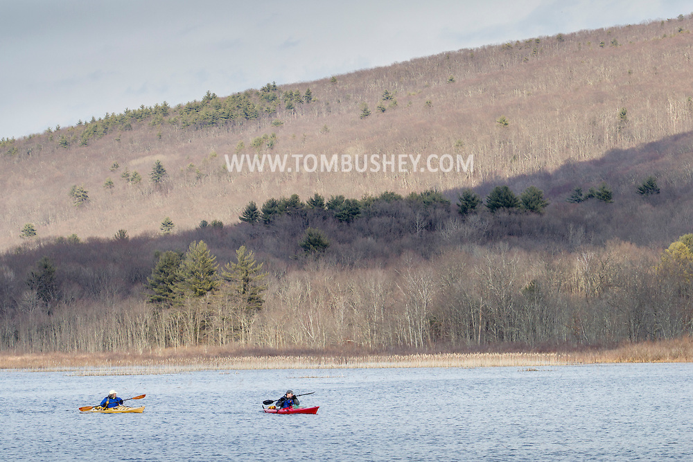 Mamakating, New York - Two kayakers cross open water on a spring afternoon at the Bashakill Wildlife Management Area  on April 5, 2015.