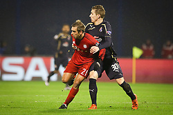 Philipp Lahm #21 of FC Bayern Munchen vs Marko Rog #30 of GNK Dinamo Zagreb during football match between GNK Dinamo Zagreb and Bayern München in Group F of Group Stage of UEFA Champions League 2015/16, on December 9, 2015 in Stadium Maksimir, Zagreb, Croatia. Photo by Ziga Zupan / Sportida