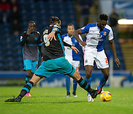 Hope Akpan of Blackburn Rovers (right) steps past Atdhe Nuhiu of Sheffield Wednesday (left) during the Sky Bet Championship match at Ewood Park, Blackburn<br /> Picture by Russell Hart/Focus Images Ltd 07791 688 420<br /> 28/11/2015