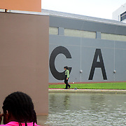 Patrons stroll past the Museum of Contemporary Art (MOCA) sign. The Museum of Contemporary Art (MOCA) was opened in 1981 and is known to feature innovative and thought-provoking works of art. (Photograph by Tatiana Prescott)