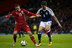 GLASGOW, SCOTLAND - Tuesday, March 29, 2016: Denmark's Henrik Dalsgaard in action against Scotland's Charlie Mulgrew during the friendly game at Hampden Park. (Pic by Lexie Lin/Propaganda)