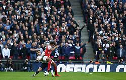 Kieran Trippier of Tottenham Hotspur and Alex Iwobi of Arsenal tussle for the ball - Mandatory by-line: Arron Gent/JMP - 02/03/2019 - FOOTBALL - Wembley Stadium - London, England - Tottenham Hotspur v Arsenal - Premier League