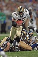 New Orleans running back Antowain Smith (32) brakes through the Rams defense into open running room in the second quarter at the Edward Jones Dome in St. Louis, Missouri, October 23, 2005.  The Rams beat the Saints 28-17.