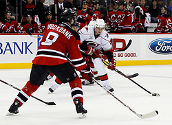 February 18, 2008; Newark, NJ, USA;  New Jersey Devils defenseman Sheldon Brookbank (8) plays defense against a shot by Carolina Hurricanes defenseman Frantisek Kaberle (5) during the third period at the Prudential Center in Newark, NJ. The Devils beat the Hurricanes 5-1.
