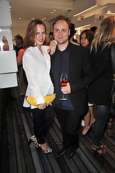 CHARLOTTE DELLAL and NICHOLAS KIRKWOOD at the opening party for Nicholas Kirkwood's new store at 5 Mount Street, London on 12th May 2011.