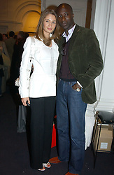 Fashion designer OZWALD BOATENG and his wife GYUNEL at the opening of the second annual Photo-London exhibition at The Royal Academy, Burlington Gardens, London on 18th May 2005.<br />