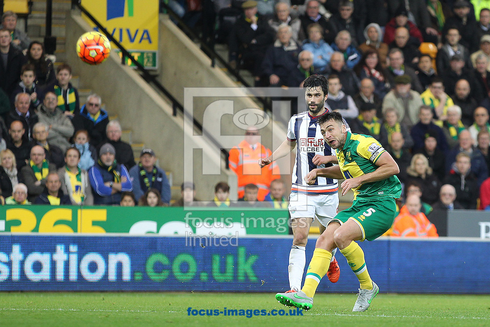 Russell Martin of Norwich has a shot on goal during the Barclays Premier League match at Carrow Road, Norwich<br /> Picture by Paul Chesterton/Focus Images Ltd +44 7904 640267<br /> 24/10/2015