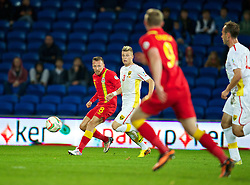 CARDIFF, WALES - Friday, October 11, 2013: Wales' Craig Bellamy crosses the ball to set-up the winning goal for Simon Church against Macedonia during the 2014 FIFA World Cup Brazil Qualifying Group A match at the Cardiff City Stadium. (Pic by David Rawcliffe/Propaganda)