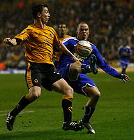 Photo: Steve Bond/Sportsbeat Images.<br /> Wolverhampton Wanderers v Leicester City. Coca Cola Championship. 22/12/2007. Iain Hume (R) tries to lift the ball over Kevin Foley (L)
