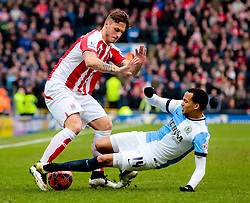 Marcus Olsson of Blackburn Rovers tackles Stoke City's Marko Arnautovic  -  Photo mandatory by-line: Matt McNulty/JMP - Mobile: 07966 386802 - 14/02/2015 - SPORT - Football - Blackburn - Ewood Park - Blackburn Rovers v Stoke City - FA Cup - Fifth Round