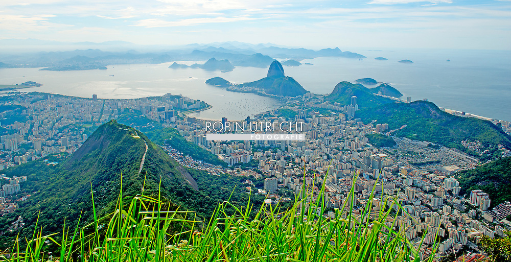 RIO DE JANEIRO - Overview of Rio de Janeiro with sugar loaf Mountain . Christ the Redeemer is a statue of Jesus Christ in Rio de Janeiro, The world cup soccer starts in 2 months on the 9 of june 2014 . COPYRIGHT ROBIN UTRECHT