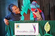 Kitty Moepang sings with Mac the Monkey during rehearsals for 'No Monkey Business', an AREPP: Theatre for Life production providing interactive social life skills education to school children through theatre productions. They are based in Johannesburg, South Africa and are about to go on tour for 3 months doing performances everyday at schools across the country.