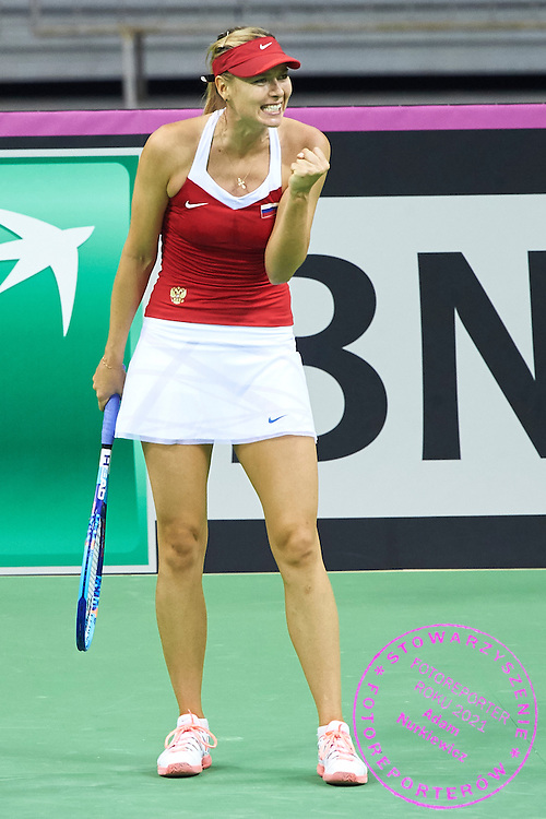 Maria Sharapova from Russia celebrates winning point during First Day of the Fed Cup / World Group 1st round tennis match between Poland and Russia at Tauron Krakow Arena on February 7, 2015 in Cracow, Poland.<br /> <br /> Poland, Cracow, February 7, 2015<br /> <br /> Picture also available in RAW (NEF) or TIFF format on special request.<br /> <br /> For editorial use only. Any commercial or promotional use requires permission.<br /> <br /> Adam Nurkiewicz declares that he has no rights to the image of people at the photographs of his authorship.<br /> <br /> Mandatory credit:<br /> Photo by &copy; Adam Nurkiewicz / Mediasport