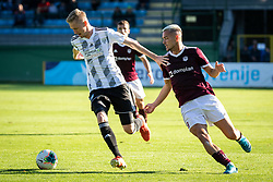 Žan Karničnik of Mura and David Tijanić of Triglav  during football match between NŠ Mura and Nk Triglav in 14th Round of Prva liga Telekom Slovenije 2019/20, on October 19, 2019 in Fazanerija, Murska Sobota, Slovenia. Photo by Blaž Weindorfer / Sportida