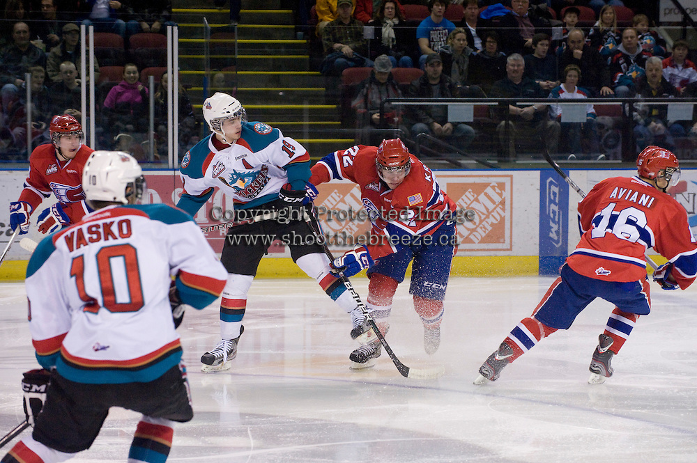 KELOWNA, CANADA, DECEMBER 27: Brett Bulmer #19 of the Kelowna Rockets is checked by Darren Kramer #22 of the Spokane Chiefs at the Kelowna Rockets on December 7, 2011 at Prospera Place in Kelowna, British Columbia, Canada (Photo by Marissa Baecker/Getty Images) *** Local Caption ***