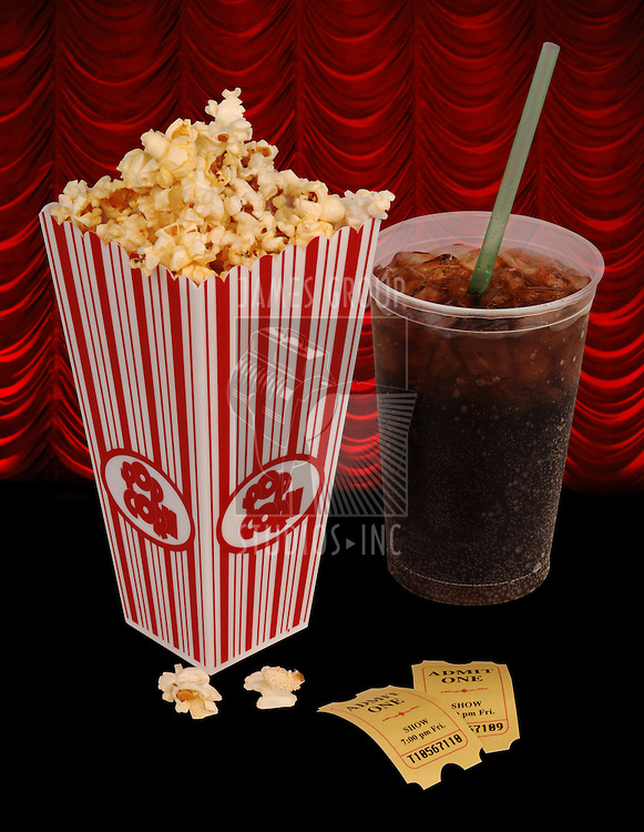 Popcorn, soda, & tickets isolated on white