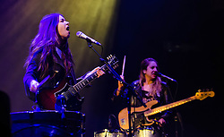 "© Licensed to London News Pictures. 05/12/2012. London, UK.   Danielle Haim (left) and Este Haim (right) of Haim performing live at The O2 Arena supporting Florence and the Machine. Haim Is a ""nu-folk-meets-nineties-R&B"" pop group from Los Angeles, California. The band is composed of sisters, Este, Danielle and Alana Haim.  Photo credit : Richard Isaac/LNP"