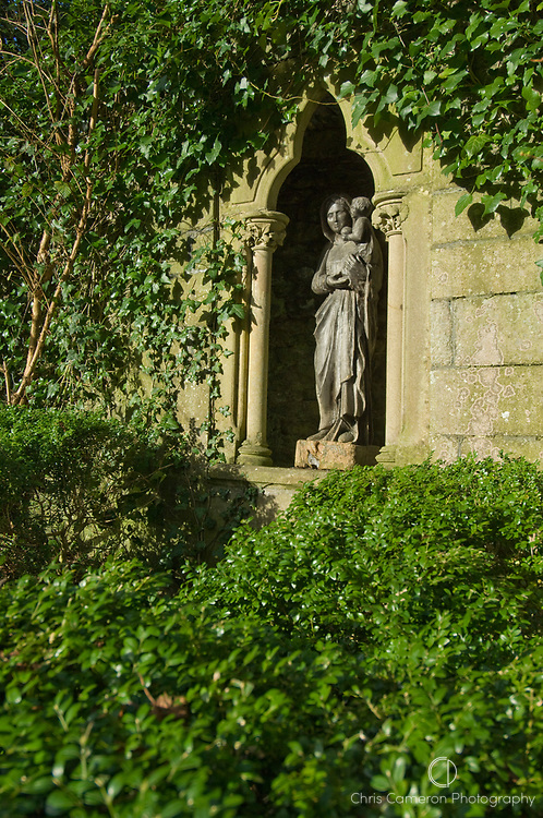 Virgin and child statue in a wall alcove in the gardens at Bunratty Castle, County Clare, Ireland.