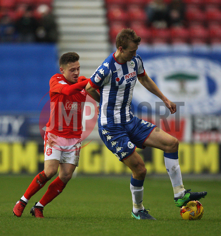 Jack Payne of Huddersfield Town (L) and Dan Burn of Wigan Athletic in action - Mandatory by-line: Jack Phillips/JMP - 02/01/2017 - FOOTBALL - DW Stadium - Wigan, England - Wigan Athletic v Huddersfield Town - Football League Championship