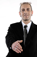 one strange caucasian punk business man with piercing and tattoos handshake welcoming salute in studio isolated on white background