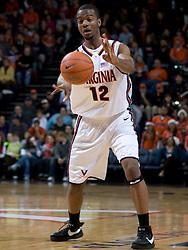 Virginia forward Jamil Tucker (12) passes against Elon.  The Virginia Cavaliers men's basketball team defeated the Elon Phoenix 91-61  at the John Paul Jones Arena in Charlottesville, VA on December 22, 2007.