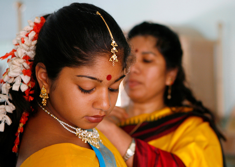 Shanta gets help putting on her sari from her mother, Suma Hareesh. Shanta got her first sari as a gift for an Indian puberty rite that marks the transition from childhood to adulthood.