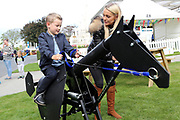 Former professional jockey Hayley Irvine instructs a young budding jockey on the execiser during the Newby and the Press Family Raceday at York Racecourse, York, United Kingdom on 9 September 2018. Picture by Mick Atkins.