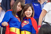 Two fans in the south stand dressed up as Supergirl look on during the first day  in the Cathay Pacific/HSBC Hong Kong 7s at Hong Kong Stadium, Hong Kong, Hong Kong on 7 April 2017. Photo by Ian  Muir.*** during *** v *** in the Cathay Pacific/HSBC Hong Kong 7s at Hong Kong Stadium, Hong Kong, Hong Kong on 7 April 2017. Photo by Ian  Muir.
