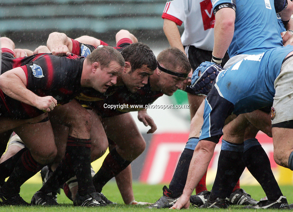 The Canterbury scrum (L-R) Campbell Johnstone, Corey Flynn and Greg Somerville pack down during the Air New Zealand Cup rugby union match between Northland and Canterbury at ITM Stadium, Whangarei, New Zealand on Saturday 5 August, 2006. Canterbury won the match 25 - 11. Photo: Hannah Johnston/PHOTOSPORT