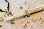 Jeweller's workbench with long nosed pliers and finger mould