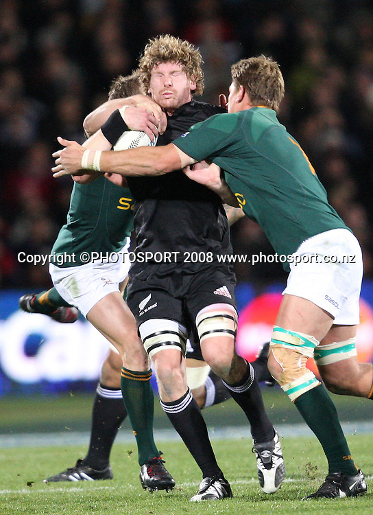 Adam Thomson is hit hard by the South African defence.<br /> Phillips Tri Nations. All Blacks v South Africa, Carisbrook, Dunedin, New Zealand. Saturday 12 July 2008. Photo: Rob Jefferies/PHOTOSPORT