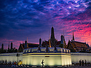 05 NOVEMBER 2016 - BANGKOK, THAILAND:  A man walks past the Grand Palace just after sunset. Crowd of mourners continue to go to the palace to honor the King,  Bhumibol Adulyadej, nearly three weeks after his death.    PHOTO BY JACK KURTZ