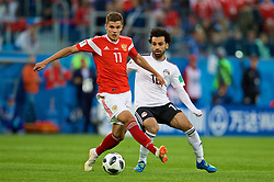 SAINT PETERSBURG, RUSSIA - Tuesday, June 19, 2018: Russia's Roman Zobnin and Egypt's Mohamed Salah during the FIFA World Cup Russia 2018 Group A match between Russia and Egypt at the Saint Petersburg Stadium. (Pic by David Rawcliffe/Propaganda)