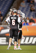 DENVER, CO - MAY 18: Jeremy Boltus #6 of the Denver Outlaws celebrates with teammate Brendan Mundorf #2 after a goal against the Rochester Rattlers during their game at Sports Authority Field at Mile High May 18, 2013 in Denver, Colorado. The Denver Outlaws won the game 20-7. (Photo by Marc Piscotty/Getty Images) *** Local Caption *** Jeremy Boltus; Brendan Mundorf