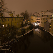 A calm, midnight snow falls in this fairytale neighborhood in Prague.