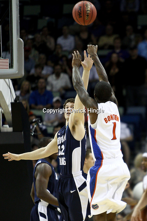 Mar 24, 2011; New Orleans, LA; Florida Gators guard Kenny Boynton (1) shoots over Brigham Young Cougars guard Jimmer Fredette (32) during the first half of the semifinals of the southeast regional of the 2011 NCAA men's basketball tournament at New Orleans Arena.  Mandatory Credit: Derick E. Hingle