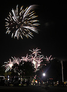 Montgomery, New York - People watch fireworks explode in the sky over a park during a fair on July 17, 2010.