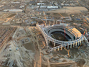 General overall aerial view of L.A. Stadium and Entertainment District at Hollywood Park under construction on Tuesday, Nov 27, 2018 in Inglewood, Calif. The venue, privately financed by Los Angeles Rams owner Stan Kroenke, is scheduled to open in 2020. It will be the home to the Rams and the Los Angeles Chargers and will play host to Super Bowl LVI in 2022, 2023 College Football National Championship and the opening and closing ceremonies of the 2028 Olympics,