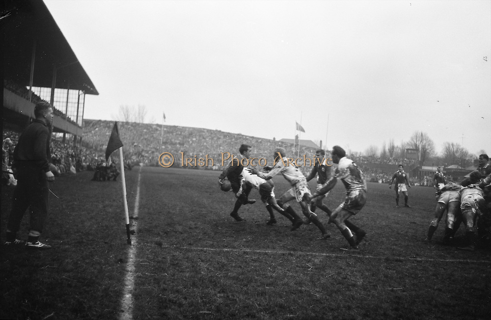 Irish Scrum, JC Kelly is in trouble as he attempts to pass to teammate English on the right,.English players tackling Kelly are, Owen, and about to pounce, DC Manley,..Irish Rugby Football Union, Ireland v England, Five Nations, Landsdowne Road, Dublin, Ireland, Saturday 9th February, 1963,.9.2.1963, 2.9.1963,..Referee- H B Laidlaw, Scottish Rugby Union, ..Score- Ireland 0 - 0 England, ..Irish Team, ..B D E Marshall, Wearing number 15 Irish jersey, Full Back, Queens University Rugby Football Club, Belfast, Northern Ireland,..W R Hunter, Wearing number 14 Irish jersey, Right Wing, C I Y M S Rugby Football Club, Belfast, Northern Ireland, ..J C Walsh,  Wearing number 13 Irish jersey, Right Centre, University college Cork Football Club, Cork, Ireland,..P J Casey, Wearing number 12 Irish jersey, Left Centre, University College Dublin Rugby Football Club, Dublin, Ireland, ..N H Brophy, Wearing number 11 Irish jersey, Left wing, Blackrock College Rugby Football Club, Dublin, Ireland, ..M A English, Wearing number 10 Irish jersey, Stand Off, Landsdowne Rugby Football Club, Dublin, Ireland, ..J C Kelly, Wearing number 9 Irish jersey, Scrum Half, University College Dublin Rugby Football Club, Dublin, Ireland,..R J McLoughlin, Wearing number 1 Irish jersey, Forward, Blackrock College Rugby Football Club, Dublin, Ireland, ..A R Dawson, Wearing number 2 Irish jersey, Forward, Wanderers Rugby Football Club, Dublin, Ireland, ..S Millar, Wearing number 3 Irish jersey, Forward, Ballymena Rugby Football Club, Antrim, Northern Ireland,..W A Mulcahy, Wearing number 5 Irish jersey, Captain of the Irish team, Forward, Bective Rangers Rugby Football Club, Dublin, Ireland,  ..W J McBride, Wearing number 5 Irish jersey, Forward, Ballymena Rugby Football Club, Antrim, Northern Ireland,..E P McGuire, Wearing number 6 Irish jersey, Forward, University college Galway Football Club, Galway, Ireland,..C J Dick, Wearing number 8 Irish jersey, Forward, Ballymena Rugby Football Club, Antrim, Northe