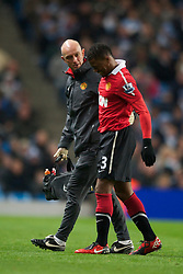MANCHESTER, ENGLAND - Wednesday, November 10, 2010: Manchester United's Patrice Evra leaves the field through injury during the Premiership match at the City of Manchester Stadium. (Pic by: Chris Brunskill/Propaganda)