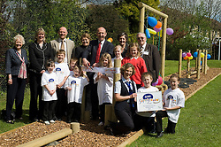 John Heeley with  Thrybergh Fullerton Church of England Primary School  Staff, Governors, Trustees and school council watch as  Royal Bank of Scotland representative Amanda Burgin presents Ryan Wood, and Terri Bailey with RBS Supergrounds certificate.26 April 2010. Images © Paul David Drabble.