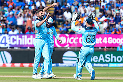 Liam Plunkett of England celebrates with Eoin Morgan of England and Jos Buttler of England after taking the wicket of Virat Kohli of India - Mandatory by-line: Robbie Stephenson/JMP - 30/06/2019 - CRICKET - Edgbaston - Birmingham, England - England v India - ICC Cricket World Cup 2019 - Group Stage