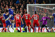 Branislav Ivanovic of Chelsea (3rd left) scores the opening goal against Liverpool during the Capital One Cup Semi Final 2nd Leg match between Chelsea and Liverpool at Stamford Bridge, London, England on 27 January 2015. Photo by David Horn.