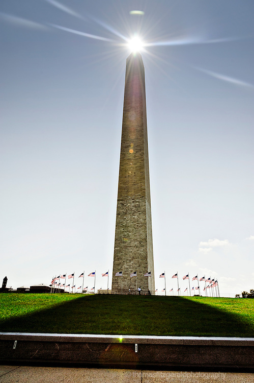 Bright flare as the Sun tips the top of the Washington Monument